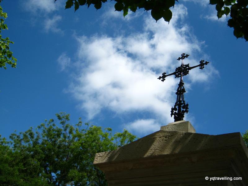 Montparnasse cemetery, cross against a blue sky