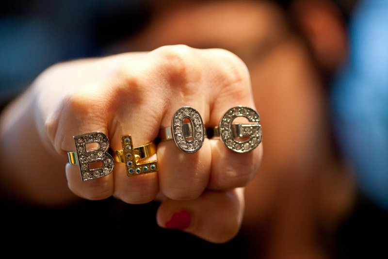 Fist with rings spelling out B-L-O-G. Image credit Thomas Hawk