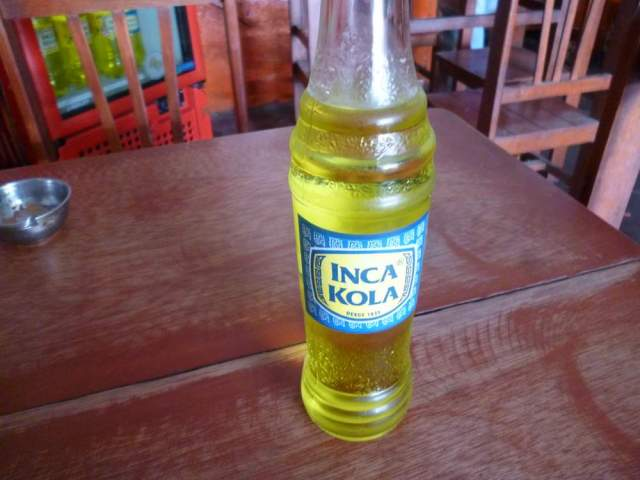 Inca Kola at a rustic Peruvian eatery in Nasca. Do you see the 2 liter bottles of Inca Kola in the fridge?